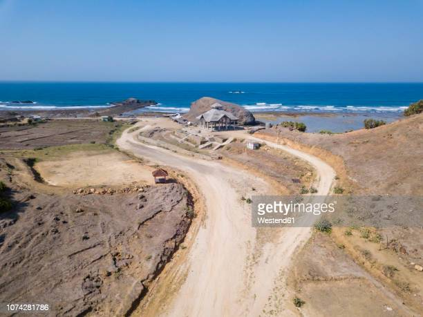 Indonesia, Aerial view of Lombok, sand track to temple