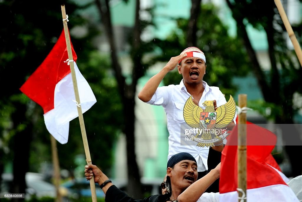 Indonesian protest against fpi in surabaya photos and images getty indonesia alliance harmony and diversity members held a march asking the indonesia police and military to reheart Image collections