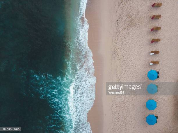 Indonesia, Bali, Aerial view of Balangan beach, empty sun loungers