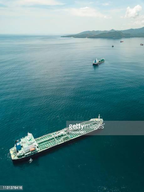 indonesia, bali, aerial view of oil tanker - indonesia logistics ストックフォトと画像