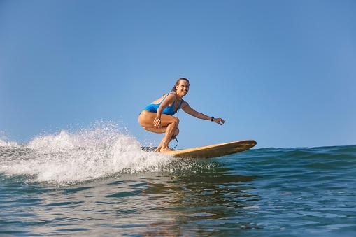 Indonesia, Bali, Batubolong beach, Pregnant woman, surfer in ocean - gettyimageskorea