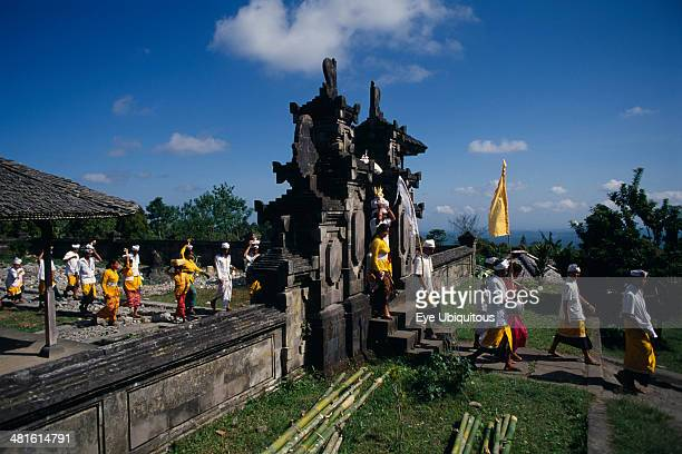 Indonesia Bali Besakih Temple Procession of mourners leaving cremation ceremony in temple grounds Besakih temple is situated on Mount Agung and known...