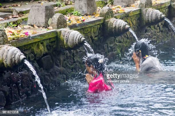 Indonesia Bali Gianyar Praying women in the water of the Hindu temple Pura Tirta Empul