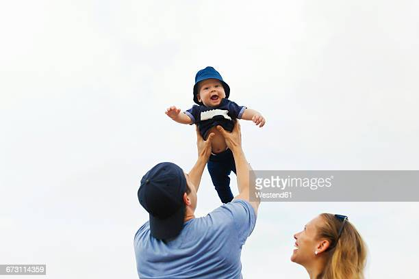Indonesia, Bali, Happy parents with baby at the beach