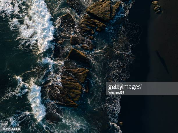 indonesia, bali, indian ocean, aerial view of rocky coast and waves - rocky coastline stock pictures, royalty-free photos & images