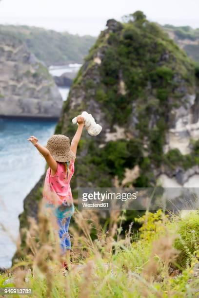 Indonesia, Bali, Nusa Penida island, girl standing on observation point