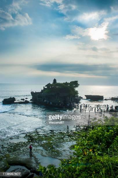 indonesia, bali, pura tanah lot - tanah lot stock pictures, royalty-free photos & images