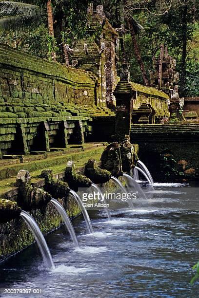 indonesia, bali, pura tirta empul temple, sacred spring - pura tirta empul temple stock pictures, royalty-free photos & images