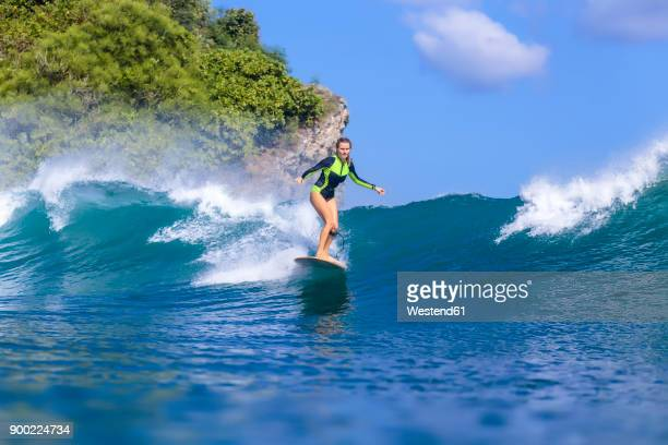 Indonesia, Bali, woman surfing