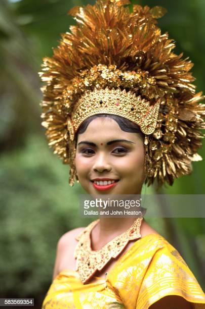 Indonesia, Bali, Young Woman Wearing Balinese Costume