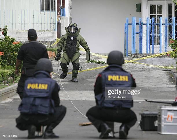 Indonesia Bomb Squad Police investigate the site of a police raid November 10, 2005 in Batu, Indonesia. Islamic radical Azahari Husin is believed to...