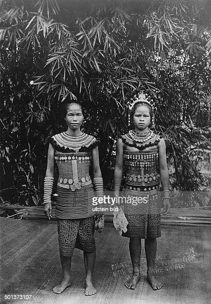 Borneo mother and daughter of the Dayak ethnic group probably in the 1910s