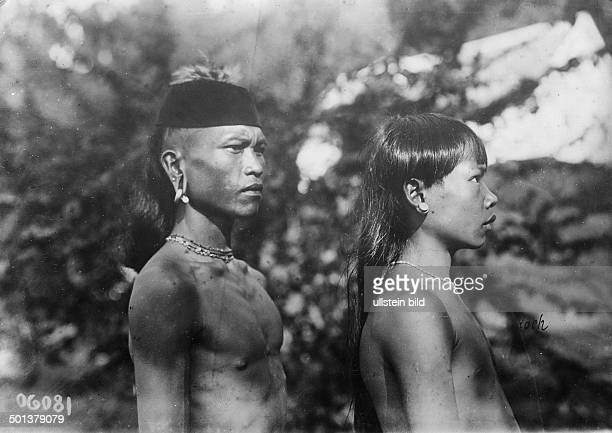 two men of the Dayak ethnic group probably in the 1910s