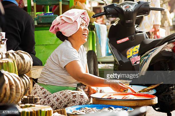 Indonesia fish market saleswoman showcases her fish