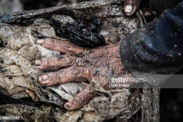 indonesia, jakarta, bantar gebang landfill, close-up of a hand. - landfill stock photos and pictures