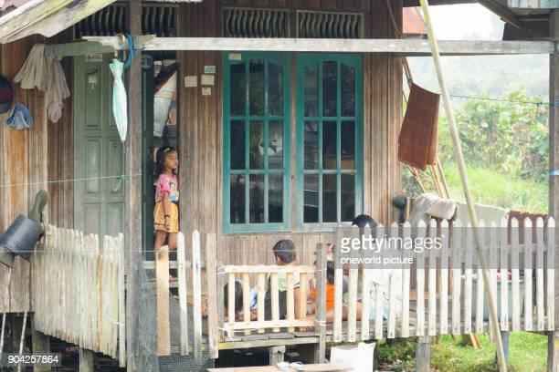 Indonesia Kalimantan Borneo Kotawaringin Barat Tanjung Puting National Park children on the balcony