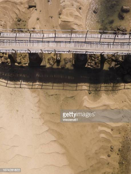 Indonesia, Lombok, Aerial view of old bridge