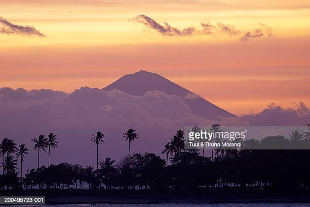 Indonesia, Lombok, Gunung Agung volcano see from Denggigi, dusk
