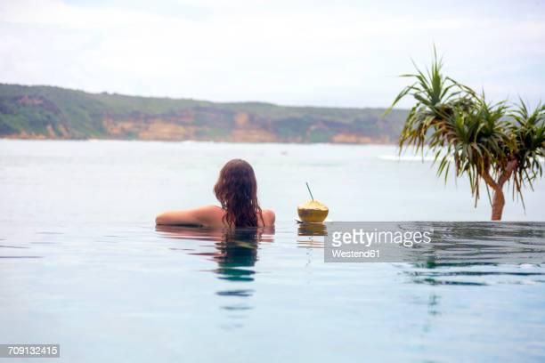 Indonesia, Lombok island, woman in infinty pool