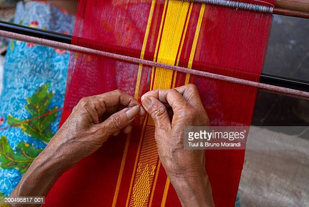 Indonesia, Lombok, man weaving Ikat