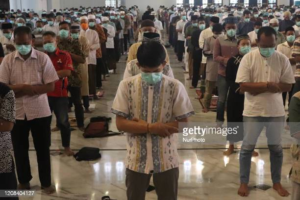 Indonesia muslim wearing face mask amid concerns over the Covid19 during friday prayers at Al Akbar Mosque in Surabaya East Java on 27 March 2020