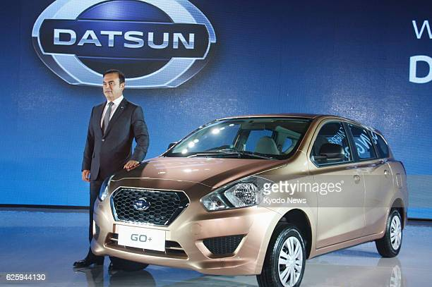 JAKARTA Indonesia Nissan Motor Co President Carlos Ghosn unveils the Datsun GO sevenseat threerow hatchback in Jakarta Indonesia on Sept 17 2013