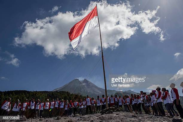 Indonesia people attend a rising of the Indonesia national flag at slope of mount Merapi during celebrations of Indonesia's National Independence Day...
