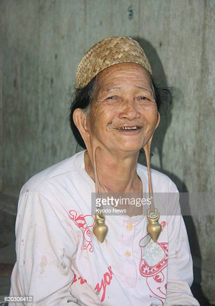 ISUY Indonesia Photo taken in February 2013 shows a woman of the indigenous Kenyah people whose earlobes are stretched in a village on Kalimantan...