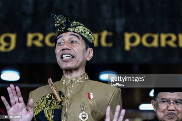 Indonesia President Joko Widodo and Vice President Jusuf Kalla react to reporters after the president address ahead of Independence Day at the...