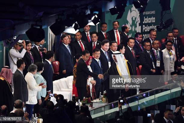 Indonesia President Joko Widodo greets Olympic Council of Asia President Ahmed AlFahad AlAhmed AlSabah during the opening ceremony of the Asian Games...