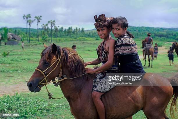 Indonesia Sawu Island Teenage Boy Girl On Horse In Traditional Ikat Costumes