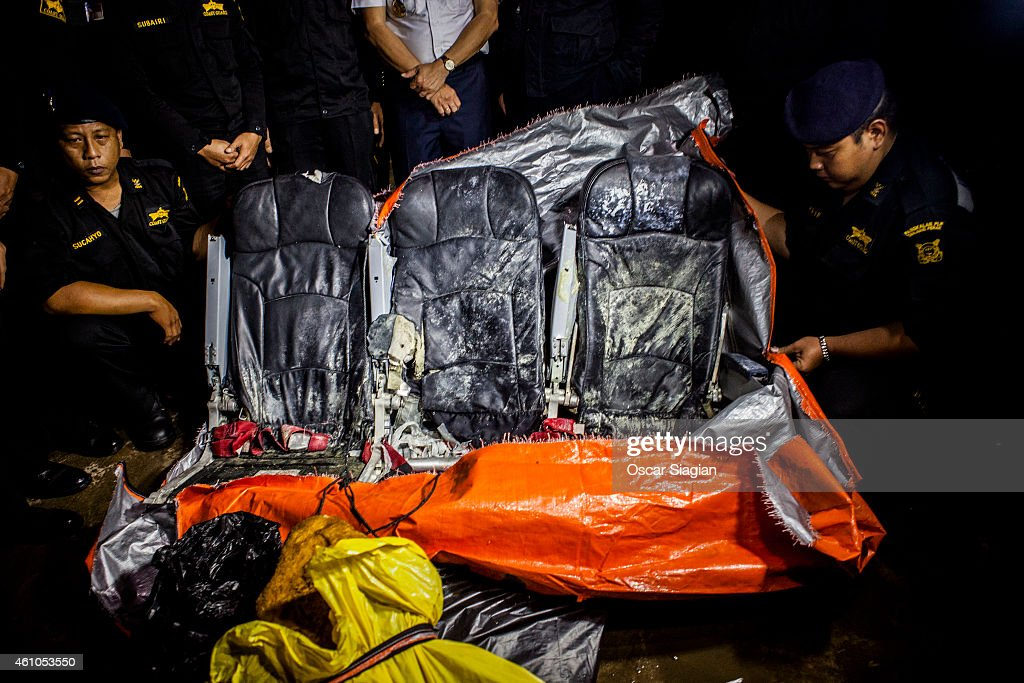 Indonesia Sea and Coast Guard display recovered seats from the AirAsia flight QZ8501 crash from the Royal Malaysian Navy KD Kasturi at Port of Kumai on January 6, 2015 in Pangkalan Bun, Indonesia. A massive recovery operation is underway in waters off Borneo to recover bodies and debris from the missing AirAsia plane. AirAsia announced that flight QZ8501 from Surabaya to Singapore, with 162 people on board, lost contact with air traffic control at 07:24 a.m. local time on December 28.