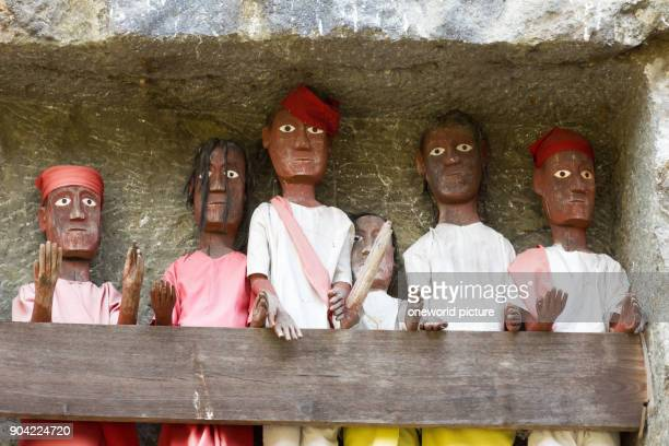 Indonesia Sulawesi Selatan Tana Toraja Torajaland Human wooden figures Dew are carved wooden figures rock tombs death cult