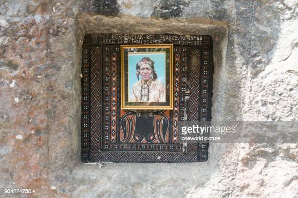 Indonesia Sulawesi Selatan Toraja Utara rock tombs with picture rock tombs death cult