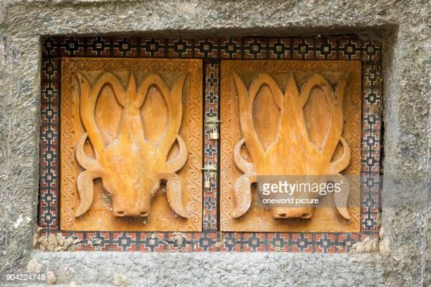 Indonesia Sulawesi Selatan Toraja Utara rock tombs with relief rock tombs death cult