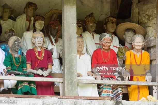 Indonesia Sulawesi Selatan Toraja Utara Torajaland Human wooden figures rock tombs death cult