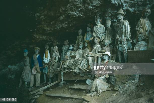 Indonesia Sulawesi Toraja wooden funeral effigies or Tau Tau set into cliff cemeteries to represent the spirit of the deceased