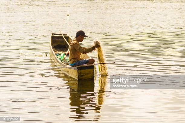 Indonesia Sulawesi Utara Kabupaten Minahasa Fisherman brings network high Lake Danau Tondano on Sulawesi Utara