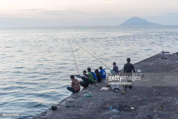 Indonesia Sulawesi Utara Kota Manado local anglers at the sea at Manado on Sulawesi Utara