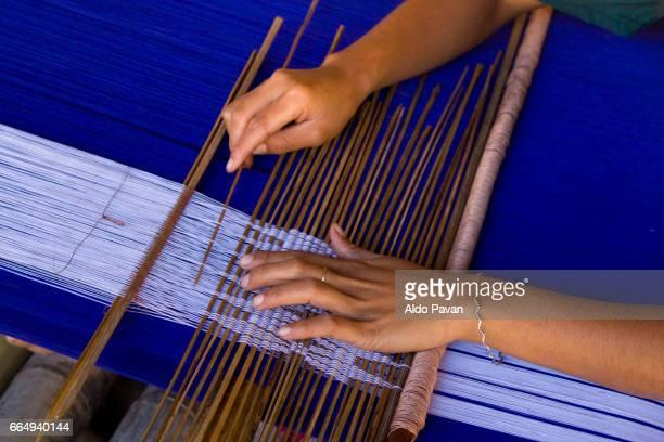Indonesia, Sumba island, Praiji village, hands of a woman weaving