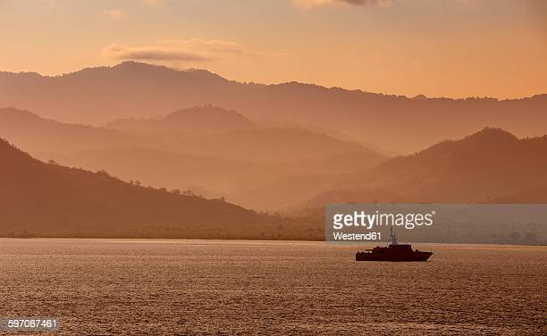 Indonesia, Sumbawa Island, Ship in the evening