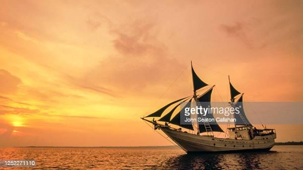 indonesia, sunset in west java - 帆船 ストックフォトと画像