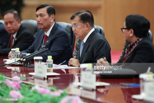 Indonesia Vice President Jusuf Kalla talks to Chinese President Xi Jinping during the bilateral meeting of the Second Belt and Road Forum at the...