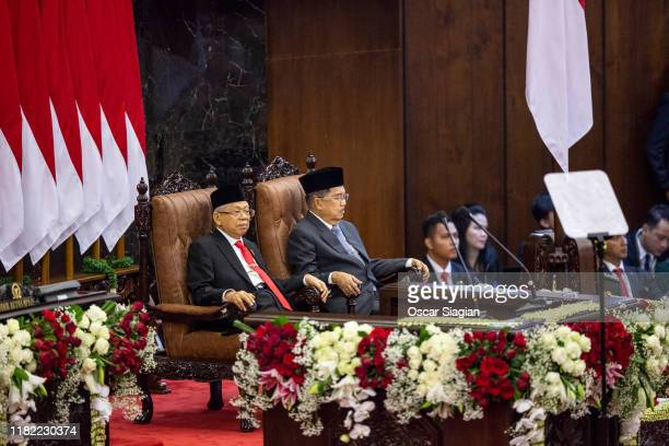 Indonesia Vice President Kyai Hajji Ma'ruf Amin sit side by side with former vice president Jusuf Kalla during inauguration ceremony at the House of...