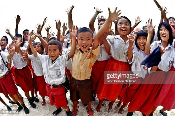 CONTENT] Indonesia West Sumatra Province Mentawai Islands children in red and white Indonesia national school uniforms