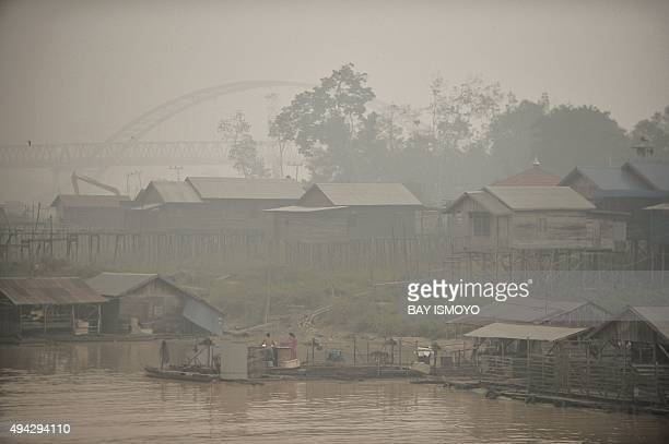Indonesiaenvironmentpollution FOCUS by Dessy Sagita In this picture taken on October 25 2015 people live by the Kahayan riverbanks the worsthit by...