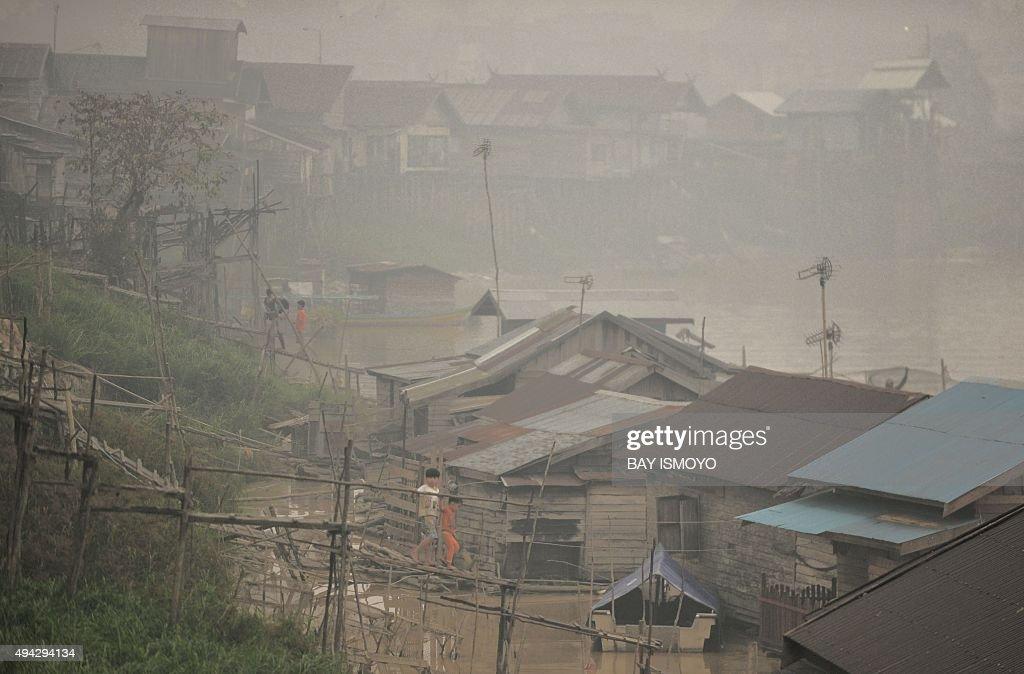 INDONESIA-MALAYSIA-SINGAPORE-ENVIRONMENT-HAZE : News Photo