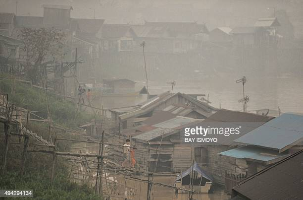 Indonesiaenvironmentpollution FOCUS by Dessy Sagita In this picture taken on October 25 2015 children play in their neighborhood by the Kahayan...