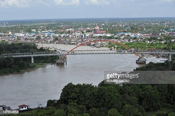 IndonesiaFranceenvironmentanimalradio This photograph taken on June 7 2012 shows a bridge over the Palangkaraya river in Palangkaraya capital of...