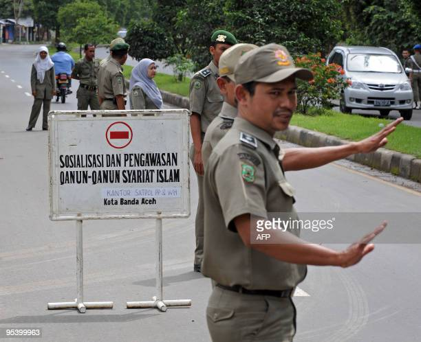 IndonesiaIslampolicerightsAcehFEATURE by Jerome Rivet This photo taken on December 2 2009 shows a team of Aceh sharia police manning a checkpoint in...